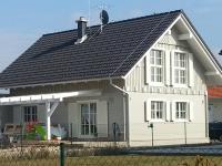 Wohnhaus  in  Blockbauweise .